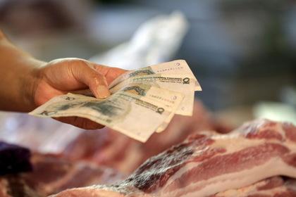 МВФ одобрил девальвацию китайской валюты