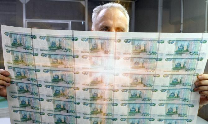 Глава ВЭБа предложил относиться к санкциям США «как к дождю» и продолжать работать